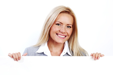 business woman hidden behind a white sheet of paper Stock Photo - 9006547
