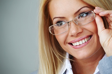 business woman in glasses on gray background Stock Photo - 9006915