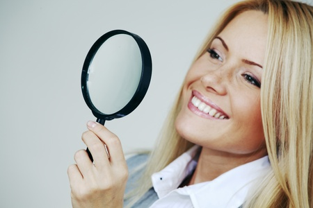 business woman looking through a magnifying glass Stock Photo - 9006808