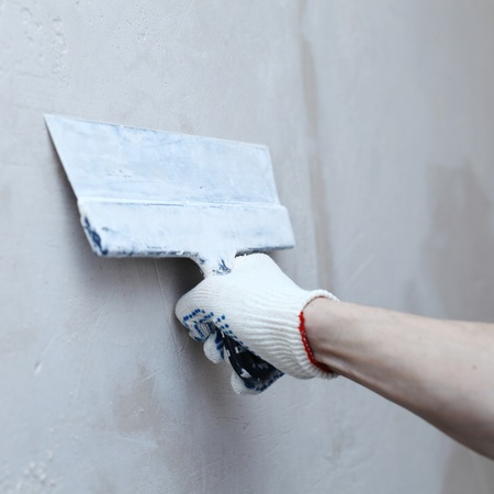 patching: work aligns with a spatula wall