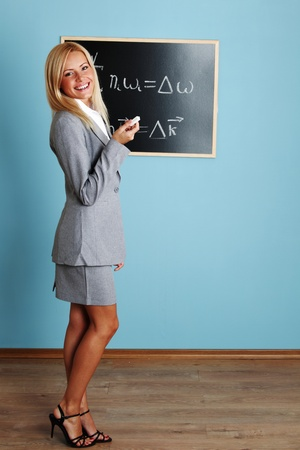 female teacher: teacher draw condition of phase synchronism Stock Photo