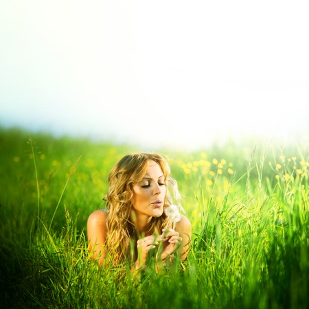 blonde lays and blow on dandelion photo