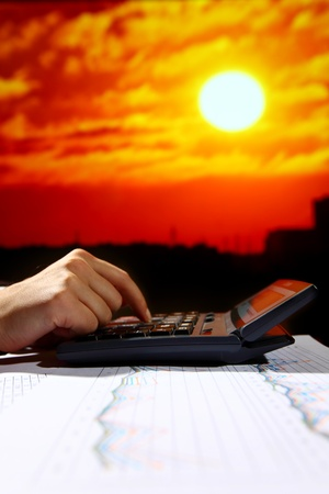 reseller early work calculate price skyscrapers under sunset photo