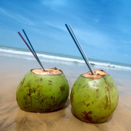 coconut cocktail on beach sand photo
