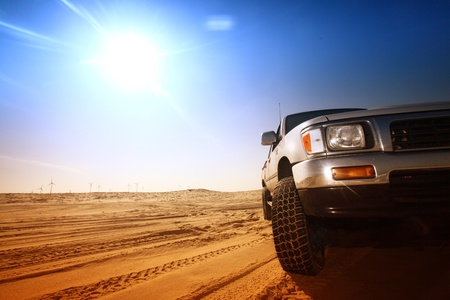 off road: truck in desert sand and blue sky