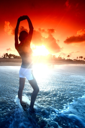 girl stay in ocean and say hello sun Stock Photo - 9067984