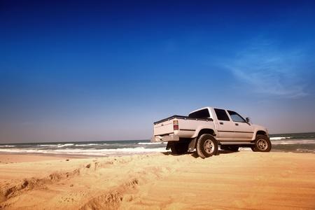 go by car to ocean coast photo