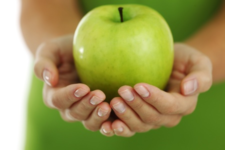 granny smith apple: green apple in woman hands