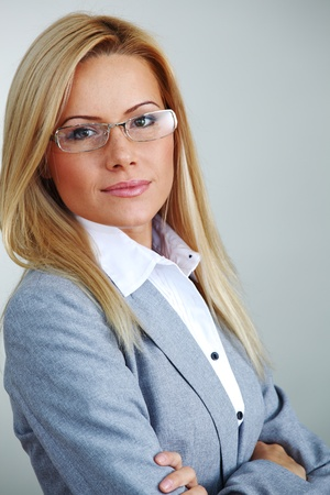 business woman in glasses on gray background Stock Photo - 9130920