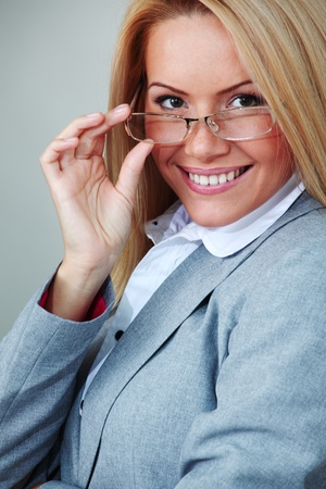 business woman in glasses on gray background Stock Photo - 9130919