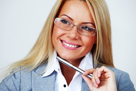 business woman in glasses on white background pen in hands Stock Photo - 9122045
