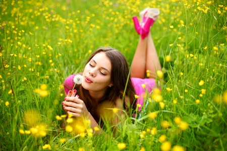 summer woman blow on dandelion  photo