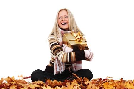 woman take autumn gift isolated in studio photo