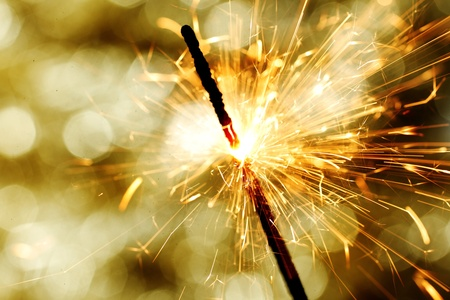 sparkler on gold  bokeh background macro close up photo