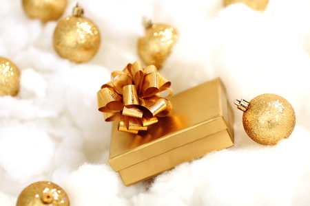 golden gifts on white close up photo