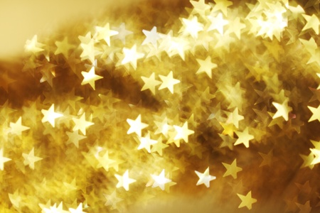 star shapes:  golden star bokeh background close up Stock Photo