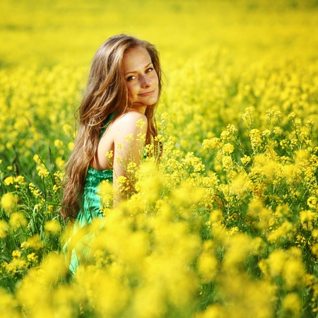 woman on oilseed field close portrait Stock Photo - 9127848