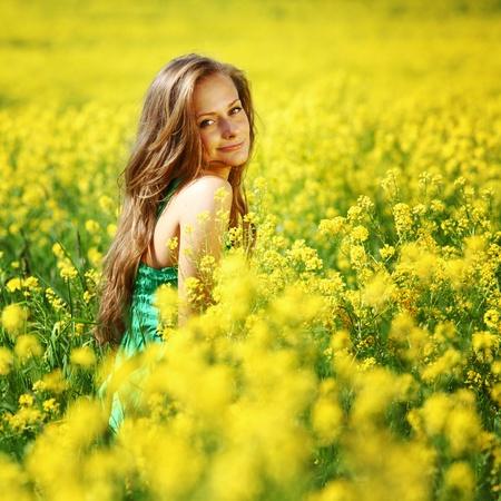 woman on oilseed field close portrait Stock Photo - 9127848
