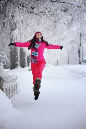 snow woman: woman run in winter park very happy