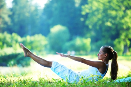 relaxation exercise:  woman lay and training on ground  Stock Photo