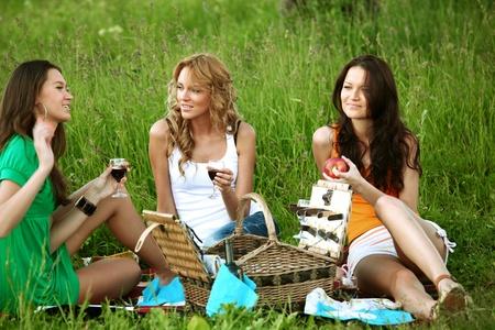 very fun girlfriends on picnic  photo