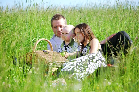 picnic of happy family on green grass Stock Photo - 9130820