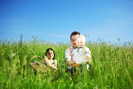 picnic of happy family on green grass Stock Photo - 9130848