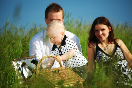 picnic of happy family on green grass photo