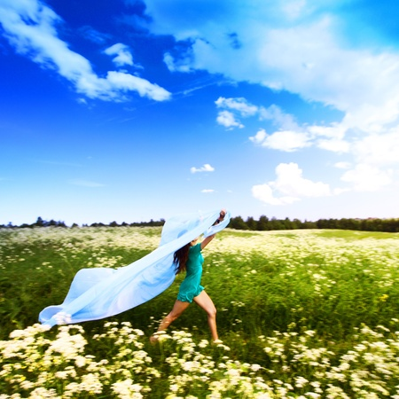 girl run by field fabric in hands fly behind like wings Stock Photo - 9128131