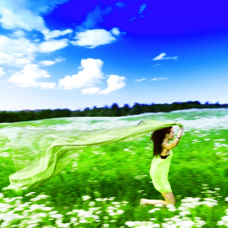 girl run by field fabric in hands fly behind like wings Stock Photo - 9122153