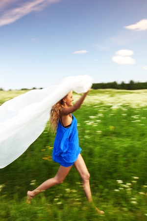 girl run by field fabric in hands fly behind like wings Stock Photo - 9122108
