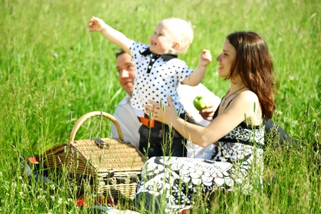 happy family on picnic in green grass photo