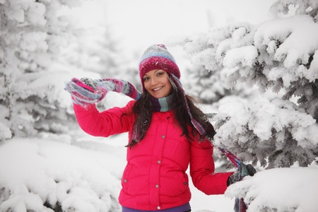 seasonal clothes: winter girl behind snow tree