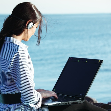 woman with laptop sea background photo