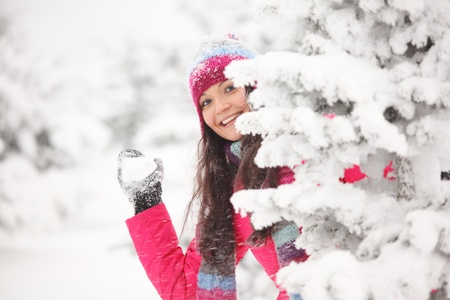 winter woman play snowballs on snow background Stock Photo - 9173592