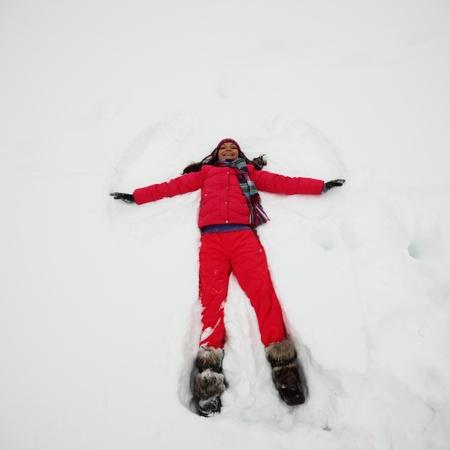 winter woman lay on snow photo