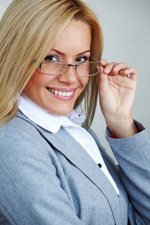 business woman in glasses on gray background Stock Photo - 9207051