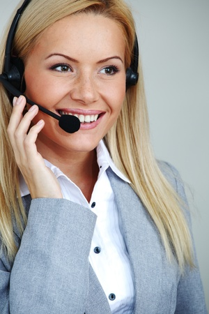 business woman with headset  on white background pen in hands Stock Photo - 9207049