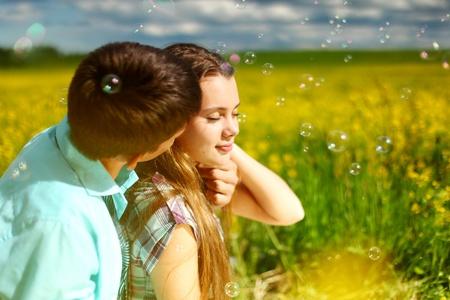 lovers hug on yellow flower field Stock Photo - 9264100