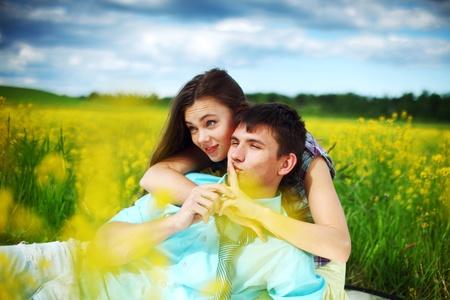 lovers hug on yellow flower field Stock Photo - 9264098