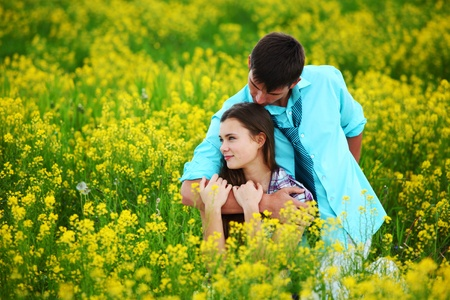 lovers hug on yellow flower field Stock Photo - 9264097