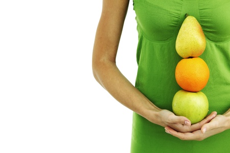 fruit pile in woman hands on white Stock Photo - 9208391