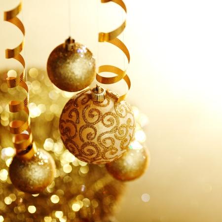 christmas eve: golden christmas balls on bokeh background Stock Photo