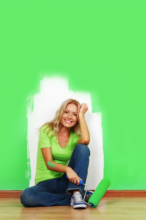 woman paints the wall brush isolated Stock Photo - 9207710