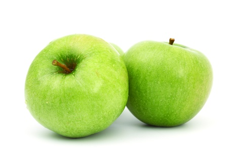green apples pile isolated on white photo
