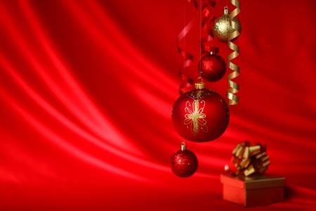 christmas balls on red satin background Stock Photo - 9248382