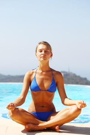 yoga woman pool on background photo