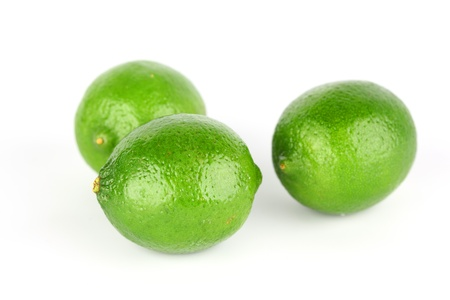 lime pile isolated on white background photo