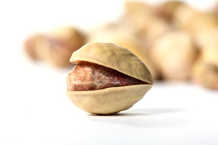 pistachios isolated on white background photo