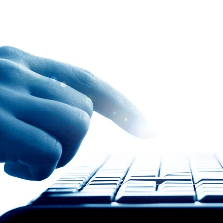 hand press a key on keyboard Stock Photo - 9258491